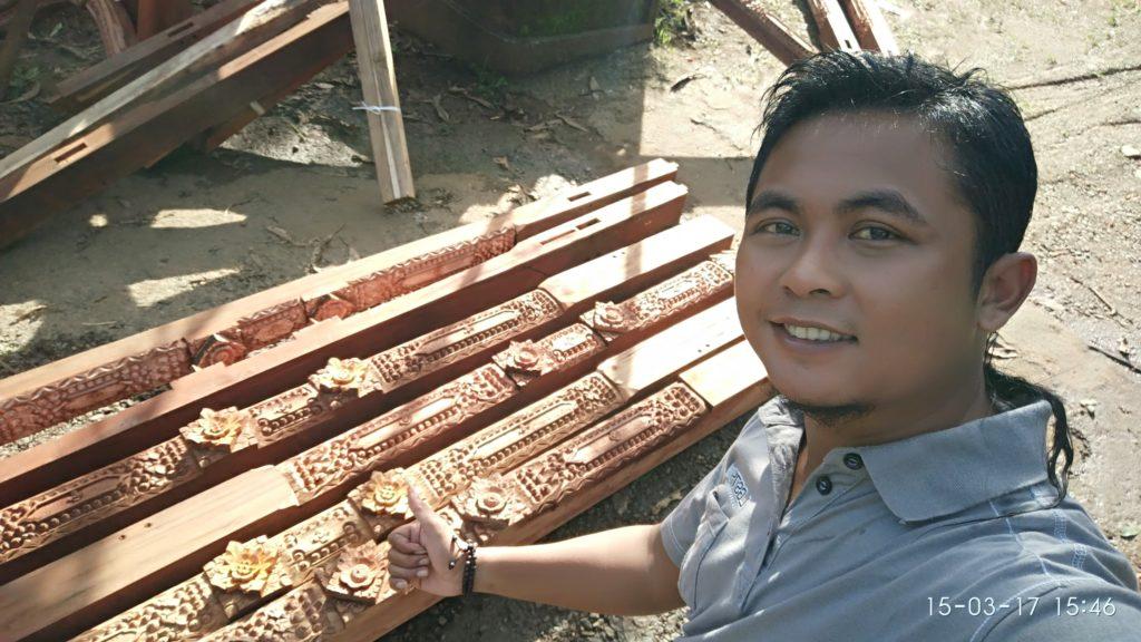 ukir tiang rumah kayu